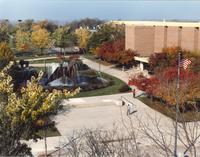 People walking by The Fountain, Campus Mall, Fall, Memorial Library in background Mid-Late 1980's, Mankato State University