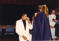 The former queen who was crowned homecoming talks to King Jr. Hill in the Centennial Student Ballroom, Mankato State University