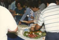 Donna Evans Retirement, people getting cake. Mankato State University. August 03, 1989.