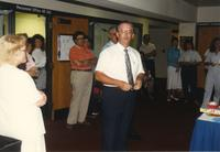 Male making an announcement at Donna Evans Retirement. Mankato State University, August 03,1989.