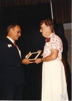 Female receiving an award at the retirement banquet located in the Centennial Student Union. Mankato State University, June , 1989.