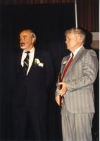 Two males standing on stage with an award at the retirement banquet located in the Centennial Student Union. Mankato State University, June 1, 1989.