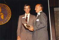 Dean Turner receiving an award at the retirement banquet located in the Centennial Student Union. Mankato State University, June 1, 1989.