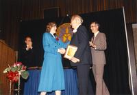 Andrew Een shaking hands with Margaret Preska after receiving an award at the retirement banquet located in the Centennial Student Union. Mankato State University, June 1, 1989.