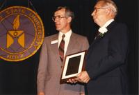 Andrew Een receiving an award at the retirement banquet located in the Centennial Student Union. Mankato State University, June 1, 1989.