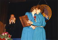 Mary Smidt shaking hands with Margaret Preska at the retirement banquet located in the Centennial Student Union, June 1, 1989.