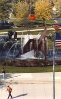 Person walking by The Fountain, Campus Mall, Fall, Mid-Late 1980's, Mankato State University