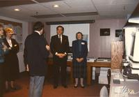 Former Minnesota governor Rudy Perpich (M) and Mankato State University President Margaret R. Preska (R) stands in the front of a classroom and talks to unidentified women and men, Mankato State University