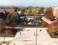 People walking by The Fountain, Campus Mall, Fall, Memorial Library and CSU in background Mid-Late 1980's, Mankato State University