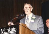 Winston Benson speaking at the Retirement Banquet located in the Centennial Student Union. Mankato State University, June 1, 1989.