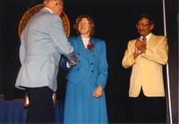 Floyd Kelley shaking hands with Margaret Preska at the retirement banquet located in the Centennial Student Union. Mankato State University, June 1, 1989.