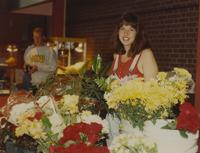 Woman selling flowers at Mankato State University. 05-17-1991.