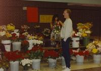 Woman selling flowers with unknown man, Mankato State University. 05-17-1991.