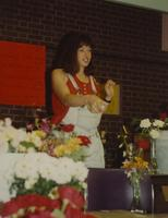 Unknown woman selling flowers at Mankato State University. 05-17-1991.