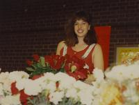 Unknown woman selling flowers, Mankato State University. 05-17-1991.