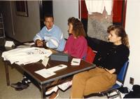 A group of unidentified students at a table selling clothes, Mankato State University