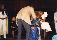 Former king and queen crowning and congratulating the new Homecoming queen in the Centennial Student Union Ballroom, Mankato State University