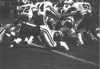 ASC football players block and tackle players from Mankato State University during a football game at Blakeslee Stadium; Mankato State University; 1989