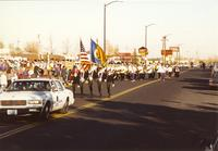 R.O.T.C's officers marching with the flags in the parade, Mankato State University