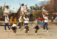 MSU's cheerleading squad performs stunts for Homecoming Week on the Campus Mall by the Centennial Student Union, Mankato State University.