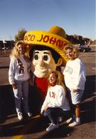Alpha Chi Omega girls striking a pose with Taco John's Mascot at the Homecoming Parade, Mankato State University