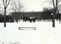 A photograph of the Fountain and Chthonic during the winter; Armstrong Hall is shown in the background; Mankato State University; 1991
