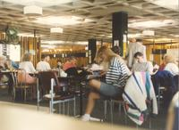 Students reading and eating on first floor of the Centennial Student Union; Mankato State University; 1991