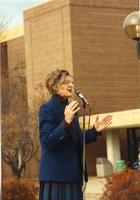 Margaret R. Preska giving an announcement outside of the Centennial Student Union, Mankato State University
