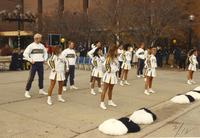 MSU's cheerleader group cheering on their players in front of students on the Campus Mall outside of the Centennial Student Union, Mankato State University.