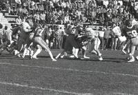 A football game at Blakeslee Stadium between Mankato State University and the SDSU Jacks; MSU players are shown blocking Jacks players; Mankato State University; 1989
