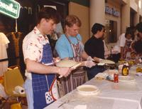 Men prepare food at the Mankato State University International Festival, 04-06-1991.