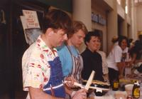 People preparing food at the Mankato State University International Festival, 04-06-1991.