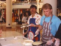 Men preparing food at the Mankato State University International Festival, 04-06-1991.