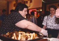 Woman serving food at the Mankato State University International Festival, 04-06-1991.