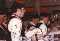 Man playing an accordion at the Mankato State University International Festival, 04-06-1991.