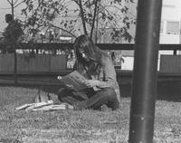 Female student studying on the grass, Mankato State University