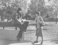 2 female students in front of Armstrong Hall, Mankato State University