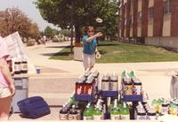 A student ring tossing outside Nelson Hall to help support and fund-raise money at Mankato State University, 1991-05-15.