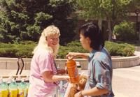 A student selling pop for a fundraiser on campus at Mankato State University, 1991-05-15.