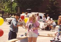 A student buying pop to help fund-raise student groups at Mankato State University, 1991-05-15.