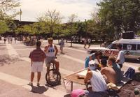 Delta Tau Delta communicating with students around campus at Mankato State University, 1991-05-15.