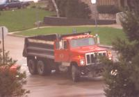 A red truck passing by campus at Mankato State University, 1991?.