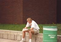 A student reading the Reporter newspaper at Mankato State University, 1991.