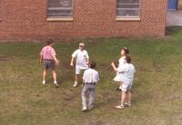 A group of students outside of McElroy Residence Community at Mankato State University, 1991.