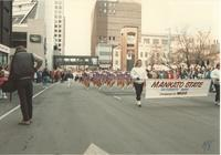 Band and cheerleaders at the winter carnival in St. Paul, Mankato State University, 1989-01-28.