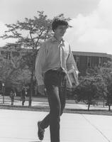 Male student walking across the Mall, Mankato State University