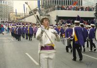 Drum major leading band at the Winter Carnival in St. Paul, Mankato State University, 1989-01-28.