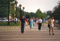 People walking on campus mall at Mankato State University. 05-23-1989.