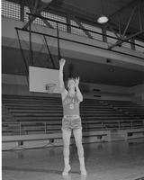Mankato State College, Phil Berg, Student Basketball Player, action shot, December 3, 1957.