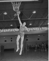 Mankato State College, male college student, basketball player, action shot, December 16, 1957.
